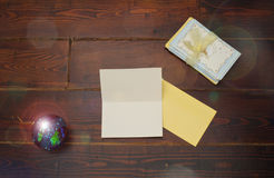 Tree ball and cards. Tree ball with christmas cards on the wooden table royalty free stock photo