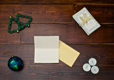 Tree ball and cards. Tree ball with christmas cards on the wooden table stock photography