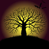 Tree and bat silhouettes Royalty Free Stock Image