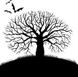 Tree and bat silhouettes Royalty Free Stock Photo