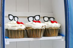 Tree Birthday Cupcakes On The Shelf Royalty Free Stock Images