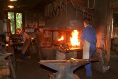 Tree blacksmith working in the smithy at Ballenberg Stock Images