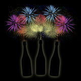 Bottles of champagne on a firework background. Tree bottles of champagne on the night firework background Royalty Free Stock Photography