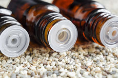 Tree bottles of essential oil. Bottles droppers tip inserts close up. Royalty Free Stock Photo