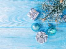 Tree branch, beautiful holiday greeting season creative , celebration card snow on a blue wooden frame. Tree branch, ball snow on a blue wooden background stock photos