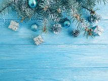 Tree branch, ball, snow on a blue wooden background, frame stock photo