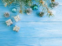 Tree branch, beautiful season ball, celebration card snow on a blue wooden background, frame royalty free stock images