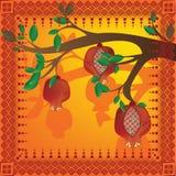 Tree branch with pomegranates Stock Image