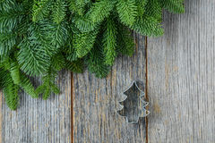 Tree branch on rustic wooden background  with cookie cutter Stock Images
