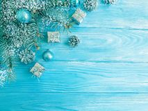 Tree branch, season ball, card snow on a blue wooden background, frame royalty free stock photos