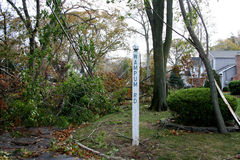Tree Branches on downed wires after Super Storm Sandy. Tree branches pulling down wires in Babylon Village after Super Storm Sandy Royalty Free Stock Images