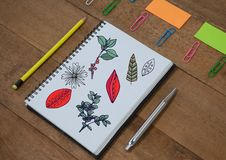 Tree branches and leafs drawn onto notepad creatively Stock Photography