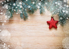 Tree branches with star and snow on wooden board Stock Image