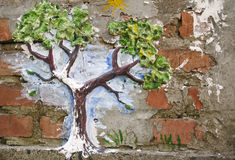 Tree on the brick wall Stock Images