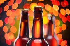Tree brown beer bottles Stock Photography