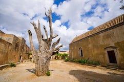 Tree with bullet - Moni Arkadiou monastery, Crete Stock Photography