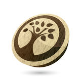 Tree button. An illustration of a tree on a wood grain button Stock Photography