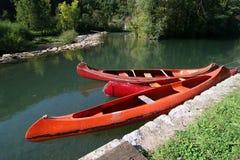 Tree canoes. Are waiting for canoing adventure on famous Slovenian river. Reka Kolpa. Slovenia Stock Photo