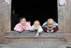 Tree Children life in the poor old village in China Royalty Free Stock Photography