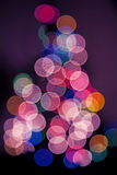A Tree of Christmas Lights. Tree of Christmas lights in pinks and blues Stock Photos
