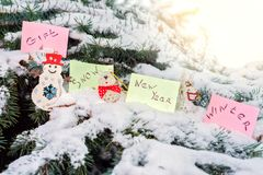 Tree Christmas toys snowman, donkey, bear, and with paper stickers and the words gift, new year, winter, snow stock photography