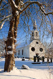 Tree and church in a white winter landscape Royalty Free Stock Images