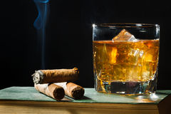 Tree cigar and whisky in the glass Stock Photography