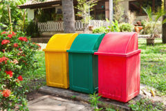 Tree color garbage bins Royalty Free Stock Photo