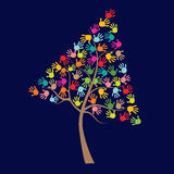 Tree with colorful baby hand print Royalty Free Stock Photography