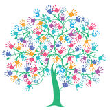 Tree with colorful hand prints Royalty Free Stock Photo