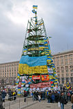 Tree construction from flags with slogans on Euro  Stock Images