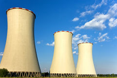 Tree cooling-towers under blue sky. With clouds Stock Photo