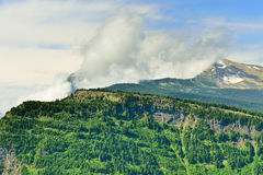 Tree-covered mountains of the Glacier National Park Royalty Free Stock Photos