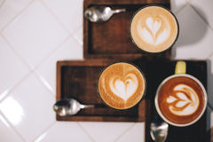 Tree cups of coffee with latte art Royalty Free Stock Photo