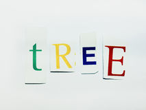 Tree - Cutout Words Collage Of Mixed Magazine Letters with White Background. Caption composed with letters torn from magazines with White Background Stock Photos