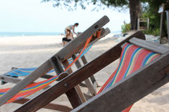 Tree deck chairs on the beach Royalty Free Stock Photo