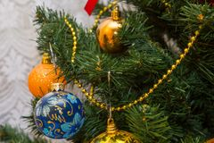 Christmas tree decorated with baubles and ribbon. Tree decorated with toys and coloured ribbons Stock Photo