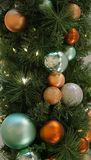 Tree decoration balls and garland close-up, vertical positioning Royalty Free Stock Photos