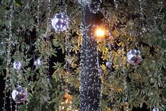Tree decoration with light and ball stock image