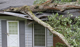 Tree Destroys House During a Storm Stock Photography