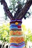 Tree. Dressed in associated spokes jacket, colorful threads, on the st Stock Photography
