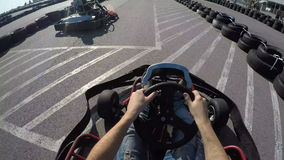 Tree drivers drive go kart, Karting filmed from the driver's view, stock video