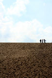 Tree in dune. Three children on top of a sand dune with blue sky Royalty Free Stock Image