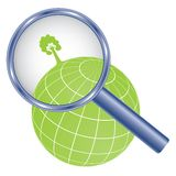 Tree on earth under magnifier glass Royalty Free Stock Photo