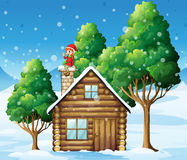 A tree with an elf at the rooftop Stock Image
