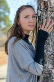 Tree in embraces of the beautiful lady. Stock Photography
