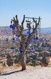 Tree and evil eye amulet in Cappadocia Turkey Royalty Free Stock Images