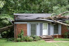 Tree Fallen on a House Stock Photography