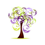 Tree with floral decoration Stock Photos