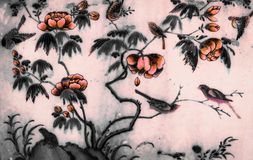 The Tree and Flowers Art paintings isolated black and white on the tiles pattern wall along the galleries of the Temple stock photography